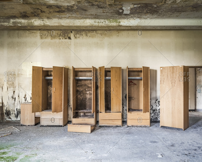 Empty wardrobes left behind in an abandoned insane asylum