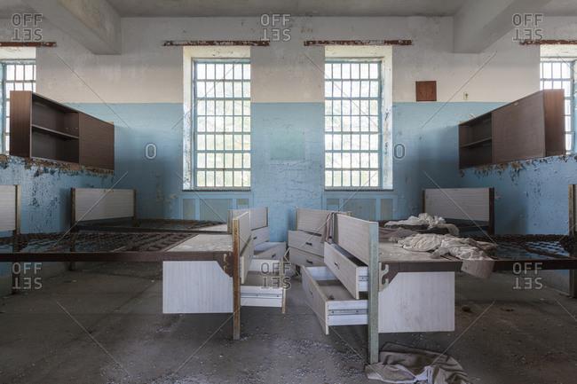 Hospital beds left behind in an abandoned mental hospital