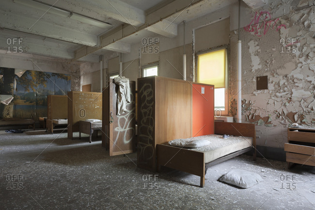 Empty patient beds left behind in an abandoned mental hospital