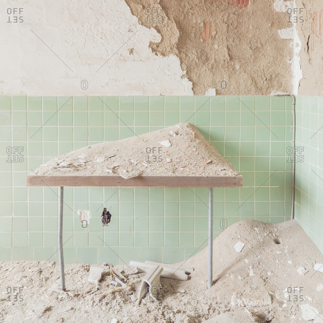 Table covered with dust in an abandoned tuberculosis hospital