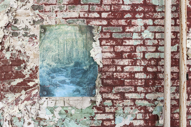 Decaying poster in an abandoned insane asylum