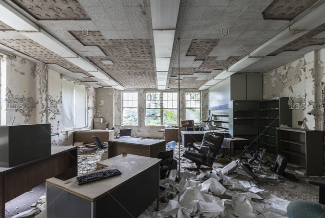 Abandoned office furniture left behind in an abandoned insane asylum