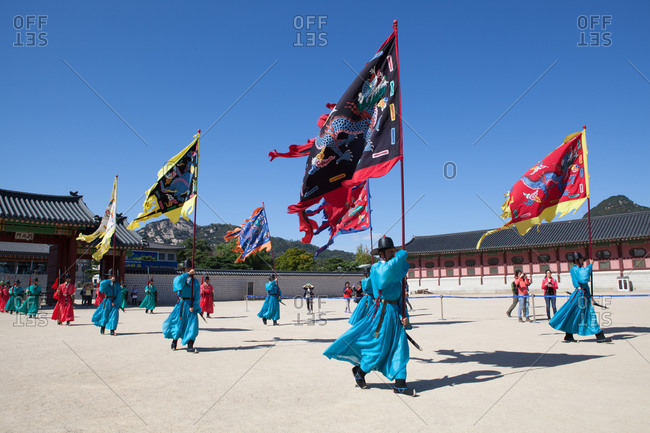 Seoul, South Korea - June 24, 2015: Korean soldiers in traditional uniform carrying flags