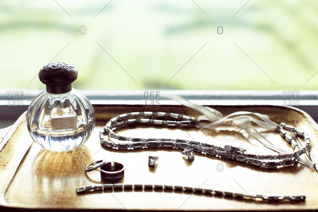 Woman's jewelry and perfume