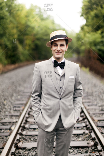 A dapper young man dressed in retro clothing