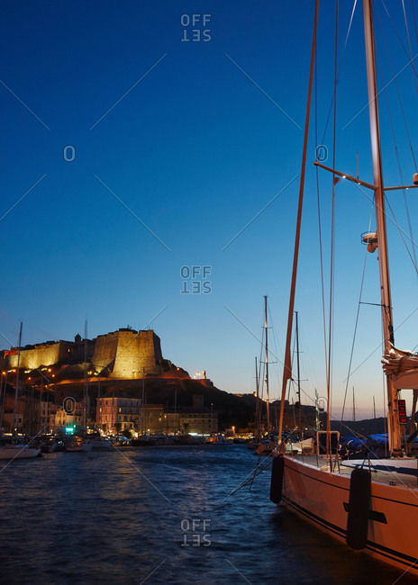 Harbor and citadel in Bonifacio, Corsica at night