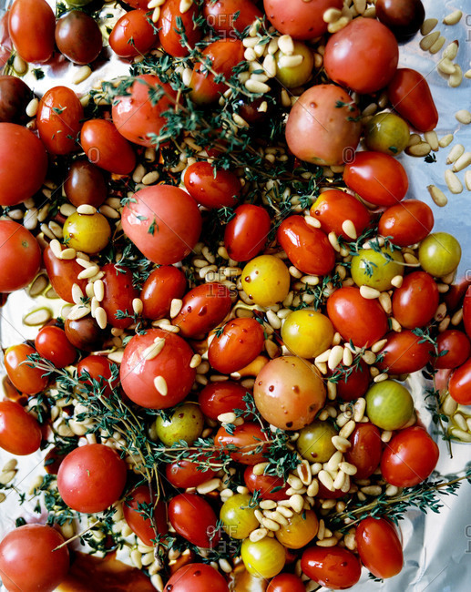 Baked cherry tomatoes with pine nuts