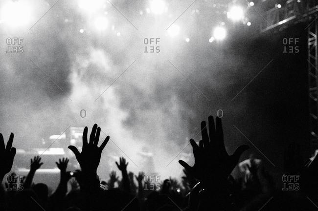 Crowd raises their hands at a rock concert