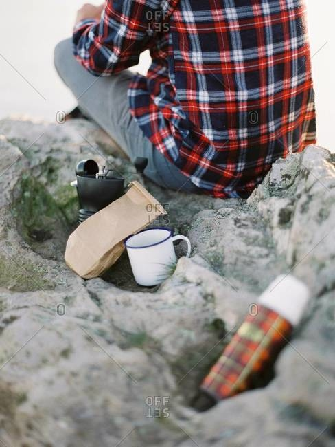 Having coffee outdoors on rocks