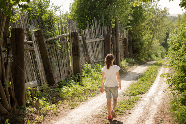 Girl walking down a country lane