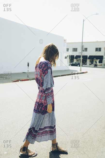 Woman in a bohemian dress on the street of a small town