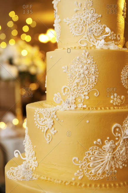 Close up of a wedding cake with lace-like decoration