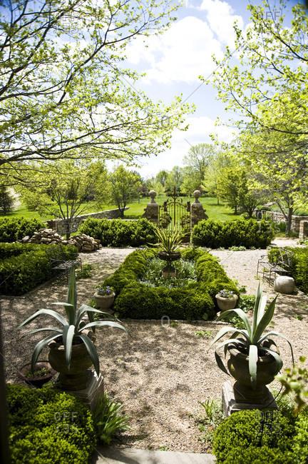 A garden enclosed in iron gates