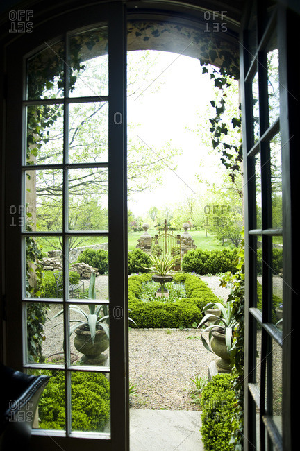A garden view through French doors