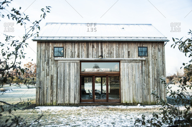 A renovated barn with mushroom wood siding