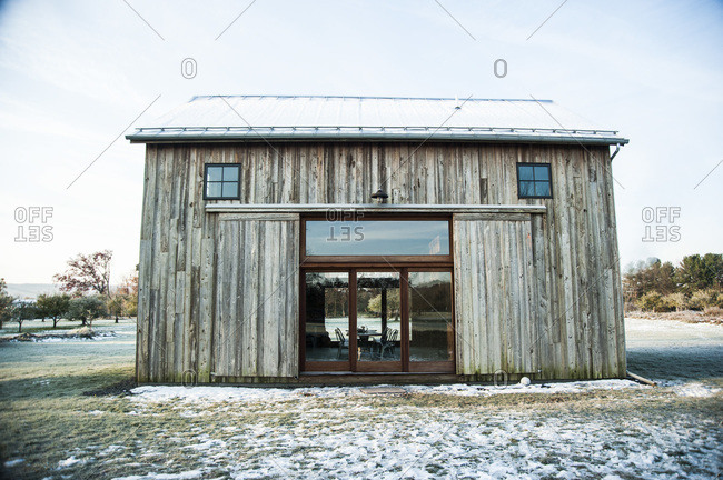 A renovated barn made with mushroom wood siding
