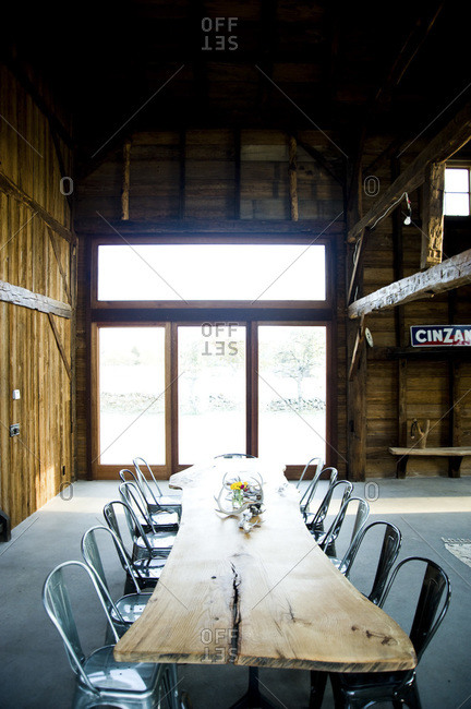 A dining table in a renovated barn