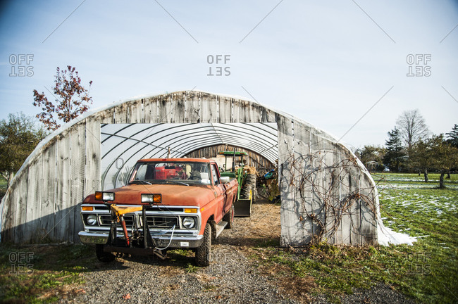 Accord, NY - October 31, 2011: A pickup truck and tractor in a hoop house