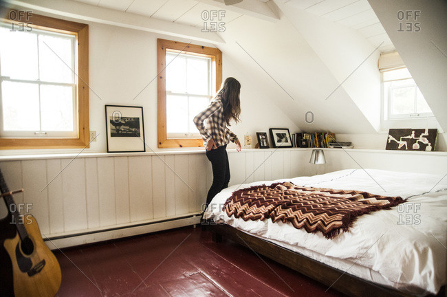 Accord, NY - October 31, 2011: A woman in a farmhouse bedroom