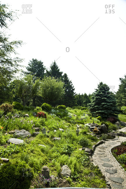 A stone path through a garden in New York