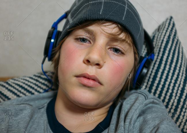 Portrait of boy listening to headphones