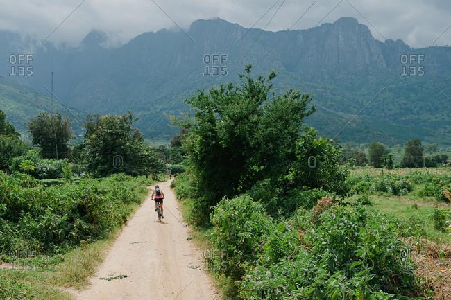 Biker on remote road in Tanzania