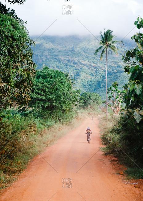 Biker on dirt road in remote Tanzania