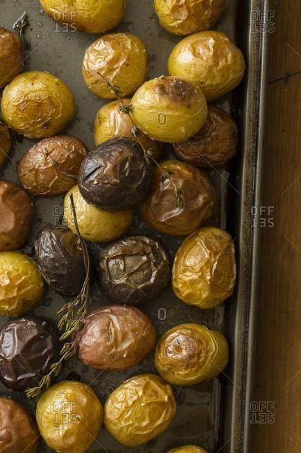 Roasted new potatoes with sprigs of rosemary