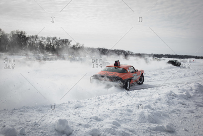 Hustisford, WI, USA - February 15, 2015: Cars racing on frozen lake