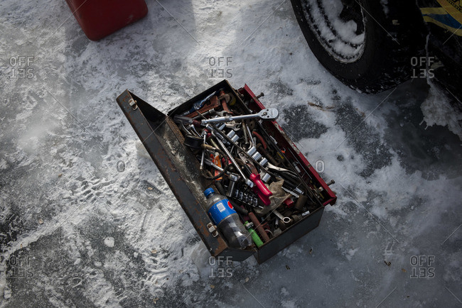 Hustisford, WI, USA - February 15, 2015: Toolbox and tools during frozen lake race