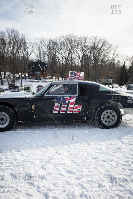 Hustisford, WI, USA - February 15, 2015: Man inside his car during winter lake race