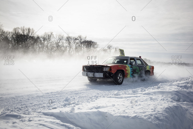 Hustisford, WI, USA - February 15, 2015: Cars in race on frozen winter lake