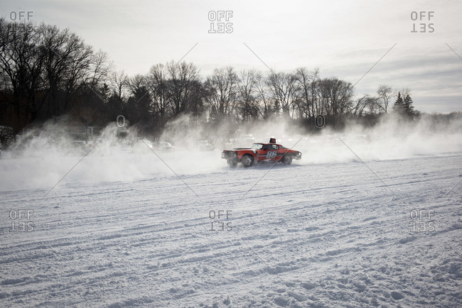 Hustisford, WI, USA - February 15, 2015: Cars racing on lake in winter