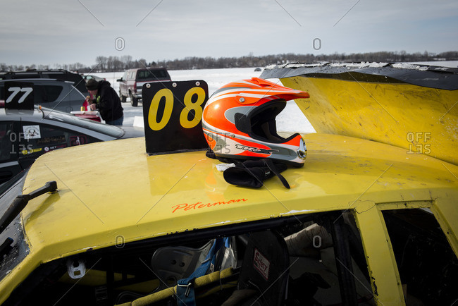 Hustisford, WI, USA - March 1, 2015: Helmet on car at winter lake race