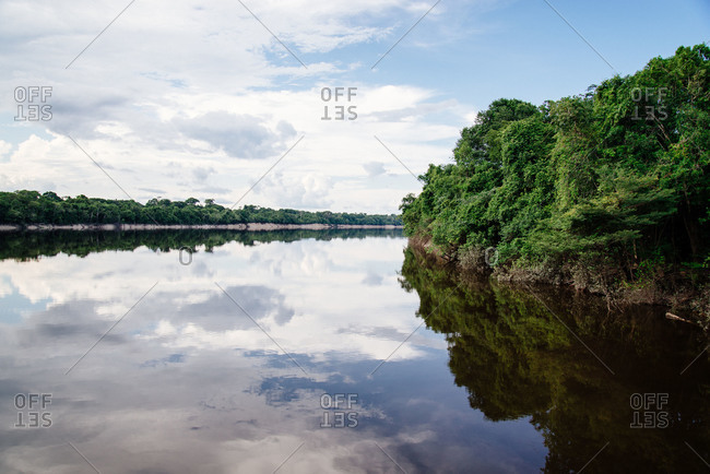 The reflective water of the Rio Negro tributary of the Amazon River in Brazil