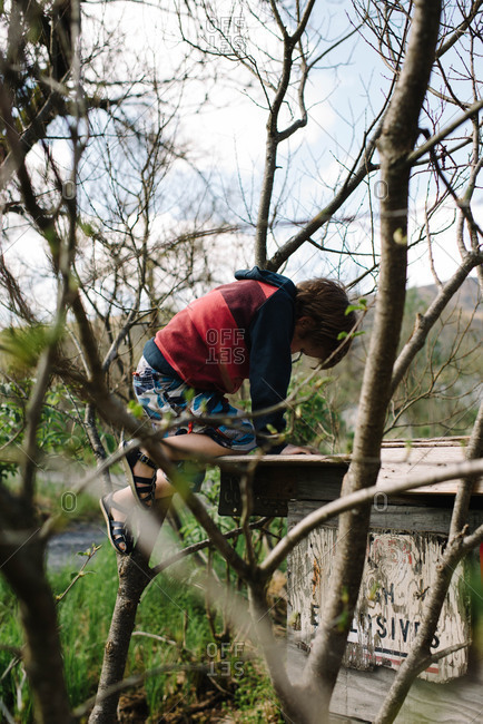 Boy exploring an old wooden structure