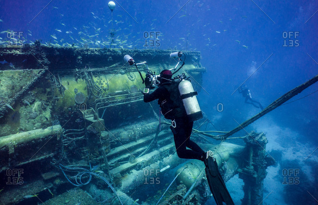 Diver taking pictures outside the Aquarius Habitat at Conch Reef