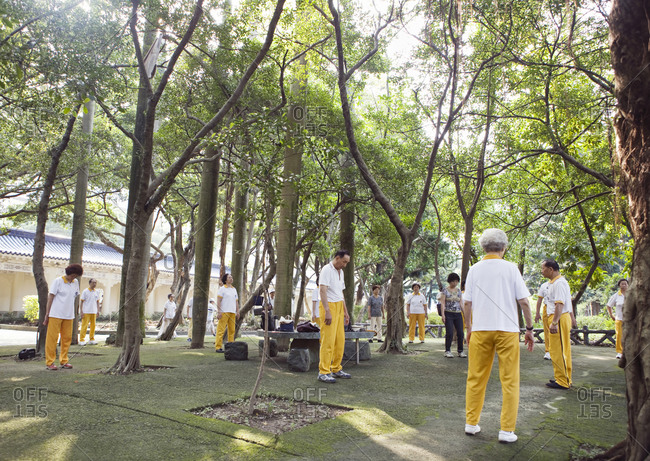 Taiwan - June 19, 2008: A group of Taiwanese people practice Tai Chi, Quigong at Taipei's Chiang Kai-shek Memorial Hall in Taipei