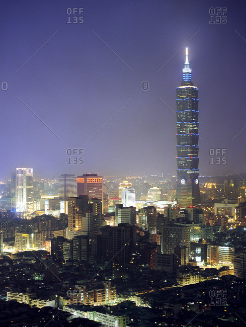 Taipei 101 building at dusk, also known as the Taipei Financial Center, it is a landmark skyscraper located in Xinyi District, Taipei