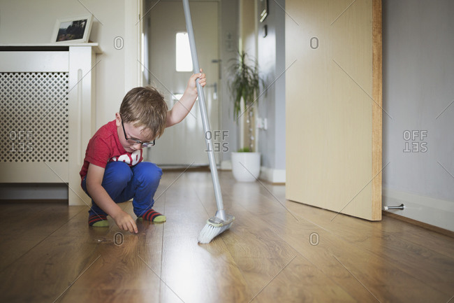 Little boy with a broom