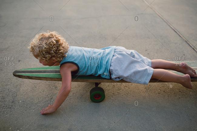 Boy lying on long board