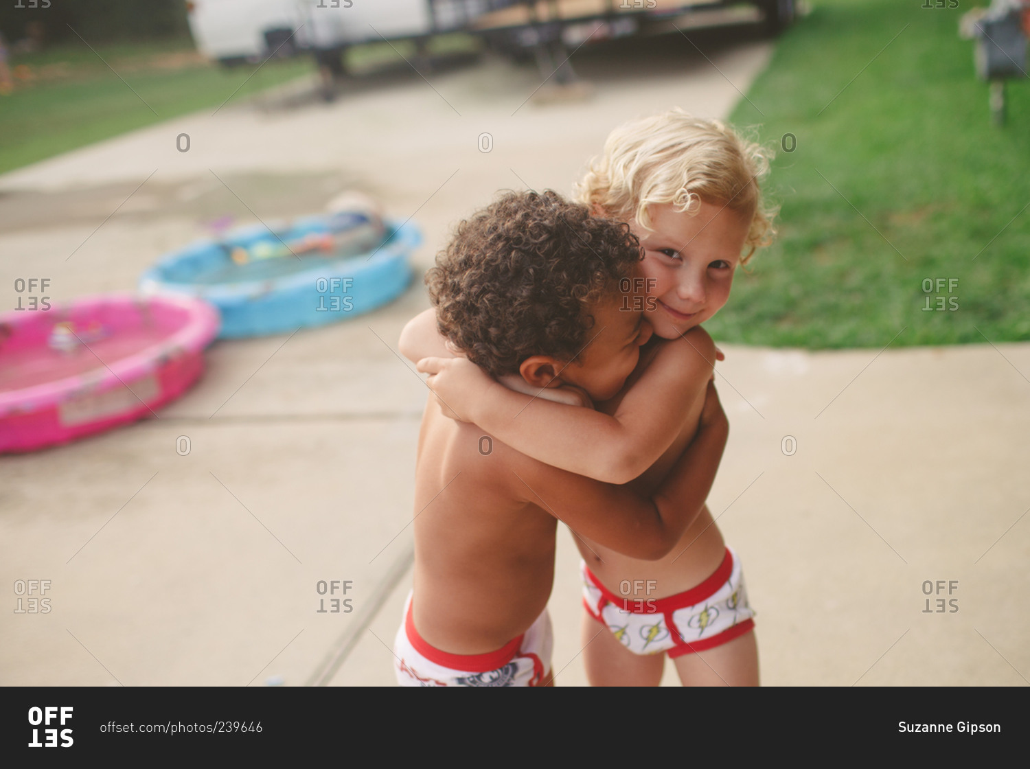 Boys in underwear playing on driveway stock photo - OFFSET