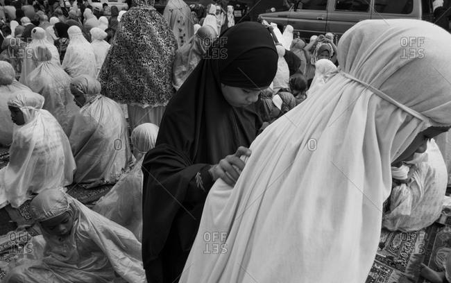 Marawi, Lanao de Sur, Philippines - August 8, 2013: Filipino women on prayer rugs