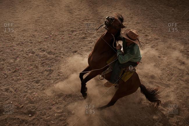 Masbate, Philippines - April 11, 2013: Cowboy riding bucking horse, Philippines