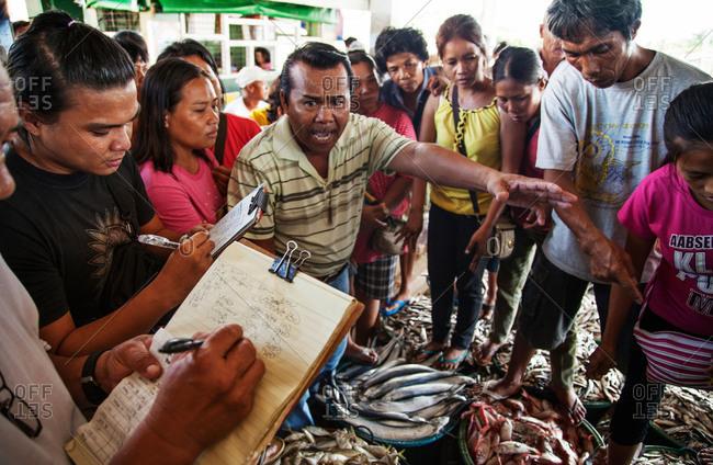 Capiz, Philippines - May 23, 2013: Trading at fish market in Capiz, Philippines