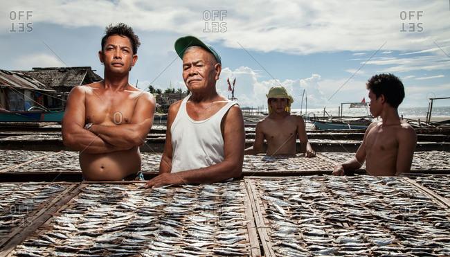 Capiz, Philippines - May 24, 2013: Fisherman and their catch, Capiz, Philippines