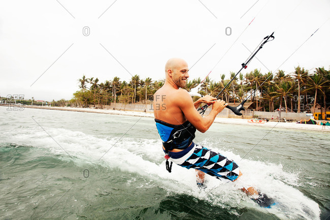 Bulabog Beach, Boracay, Philippines - February 19, 2013: Kitesurfer riding in Philippine ocean