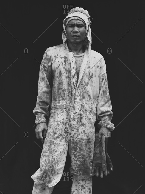 Bukidnon, Philippines - May 17, 2013: Banana plantation worker in coveralls, Philippines