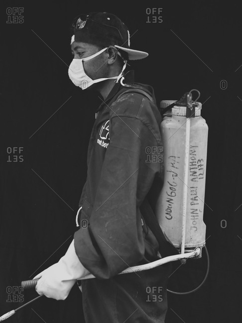 Bukidnon, Philippines - May 17, 2013: Banana plantation worker with spray equipment, Philippines
