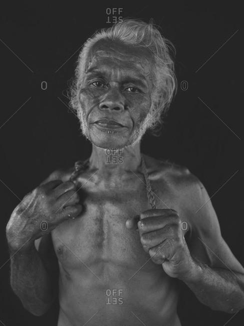 Bukidnon, Philippines - May 23, 2013: Elderly fisherman portrait, Philippines